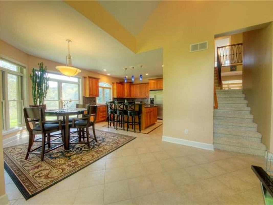 The kitchen has cherry cabinets, granite countertops and stainless-steel appliances, including a double oven. There's also a kitchen island that seats three as well as a breakfast nook and a secondary living room that connects to the kitchen area.