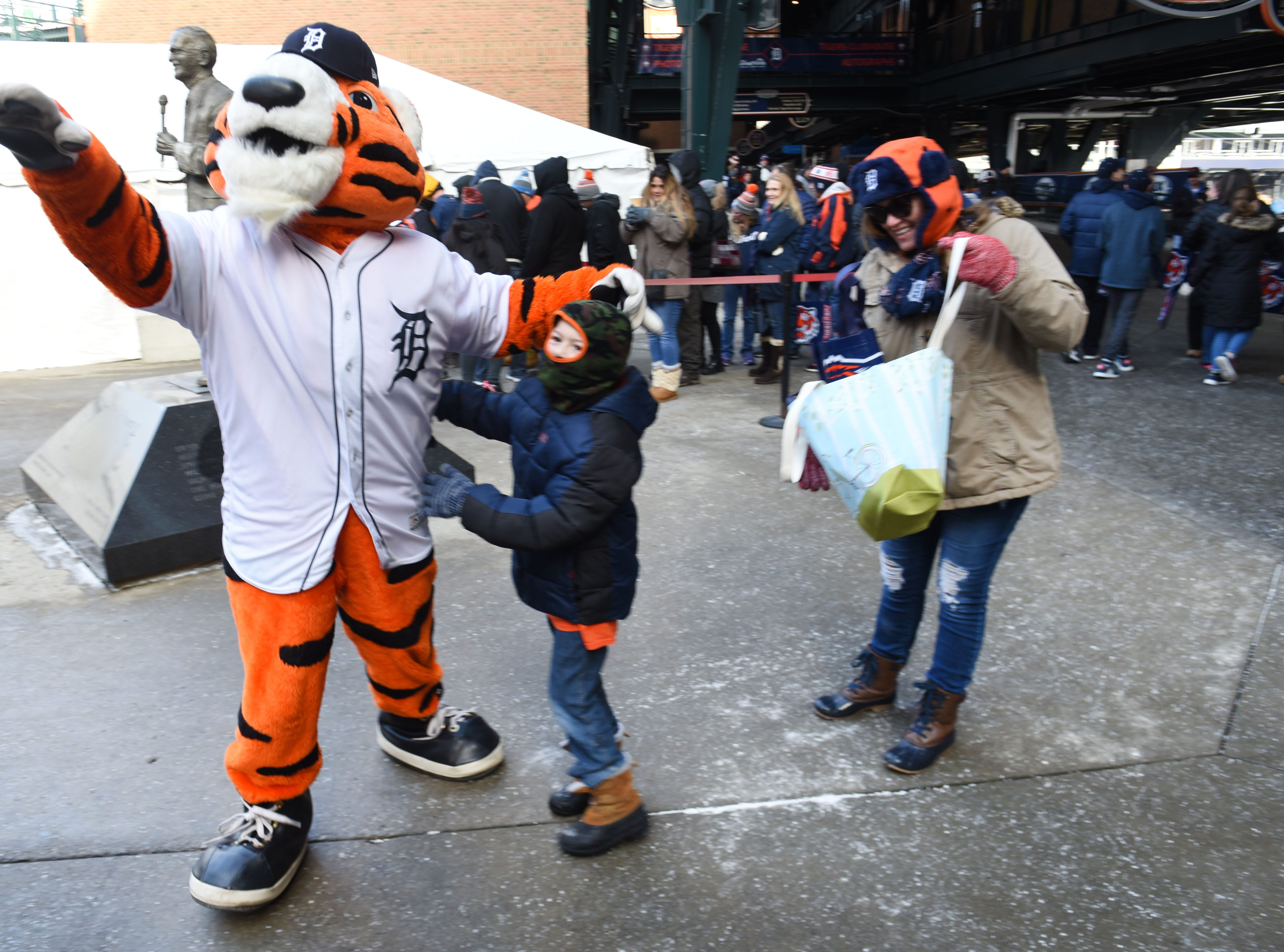 Detroit Tigers mascot Paws has fun with fans at TigerFest on Saturday, January 26, 2019.