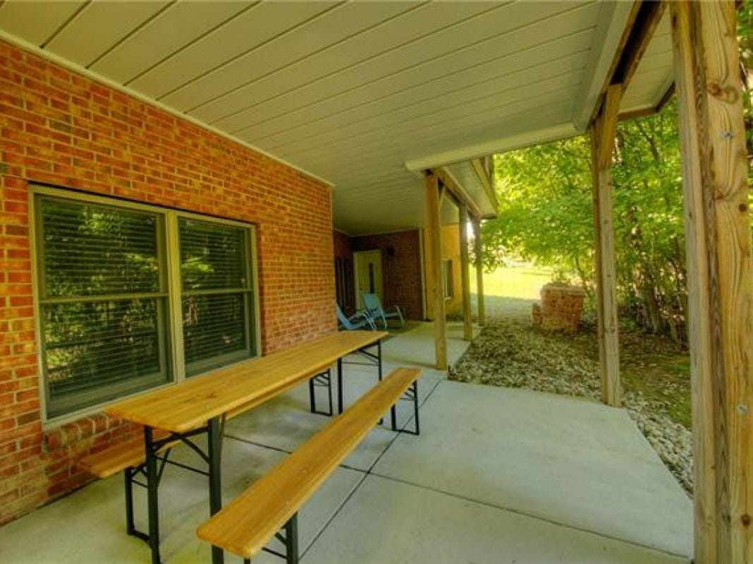 Outside, the home has an attached three-car garage and a composite wood deck that overlooks the woods.