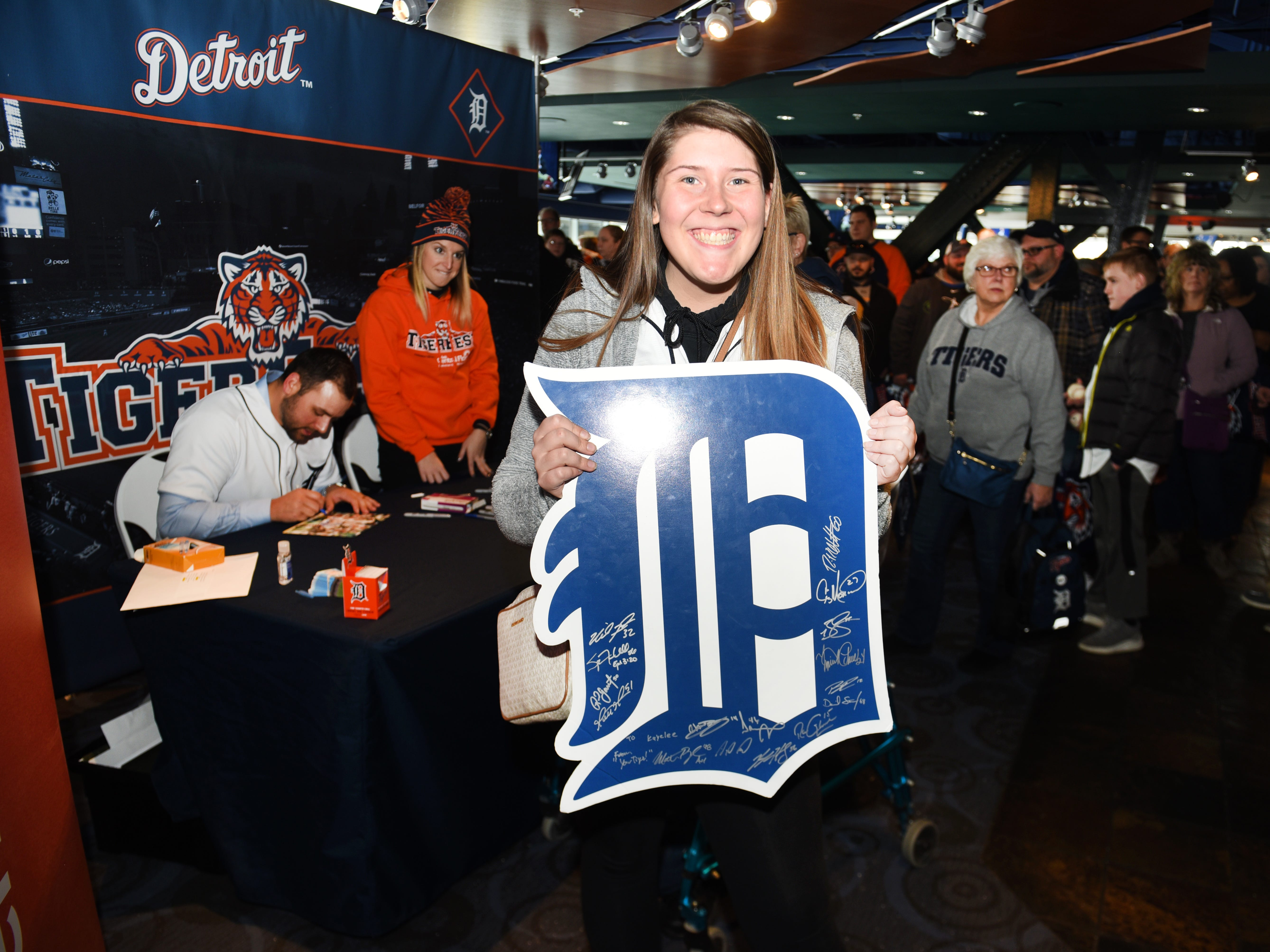Kayelee Dunn of Jackson shows off her signed big D during TigerFest 2019 at Comerica Park in Detroit on Saturday, January 26, 2019.