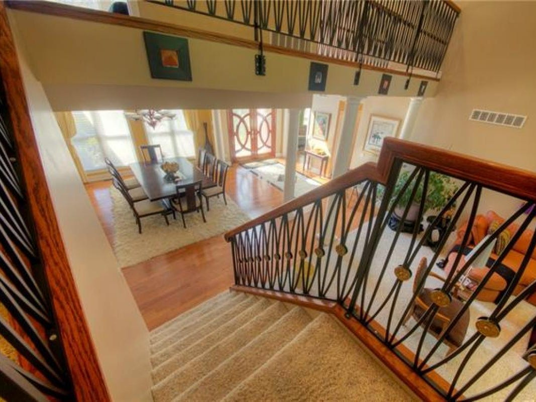 The entrance has a two-story foyer and the house has vaulted ceilings throughout the first floor. There are  two fireplaces in two living rooms on the home's first level.