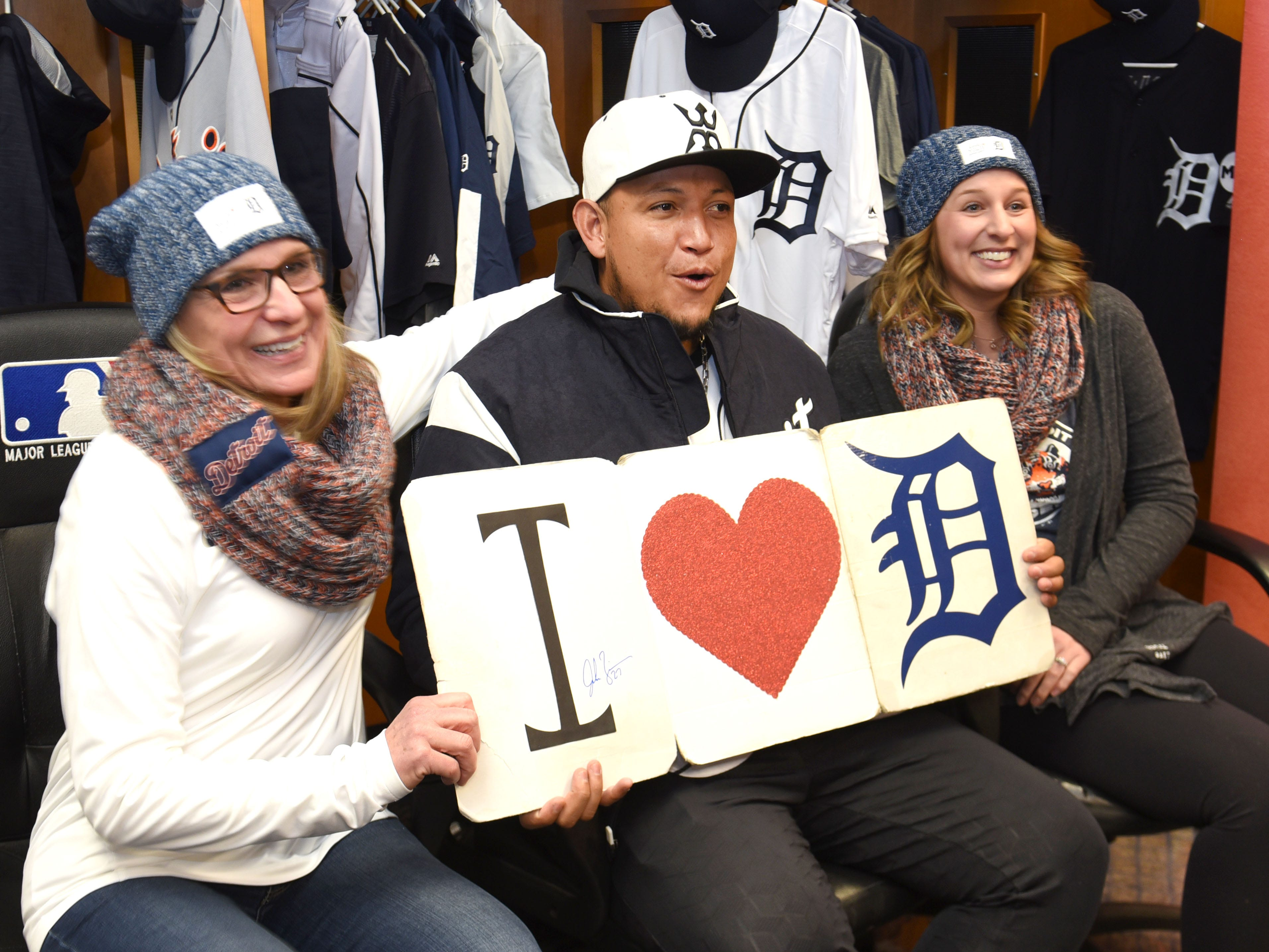 Detroit Tigers first baseman Miguel Cabrera is loved by Pam Theisen (left) and her daughter Katie of Flatrock at Comerica Park for TigerFest on Saturday, January 26, 2019.