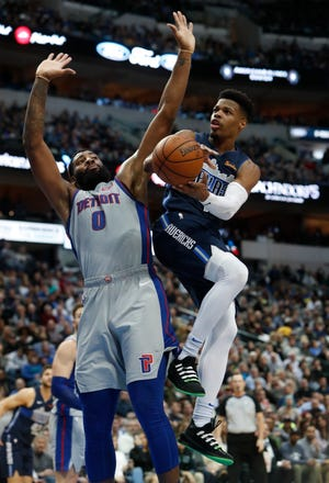 Dallas Mavericks guard Dennis Smith Jr.  drives against Detroit Pistons center Andre Drummond during the second half.