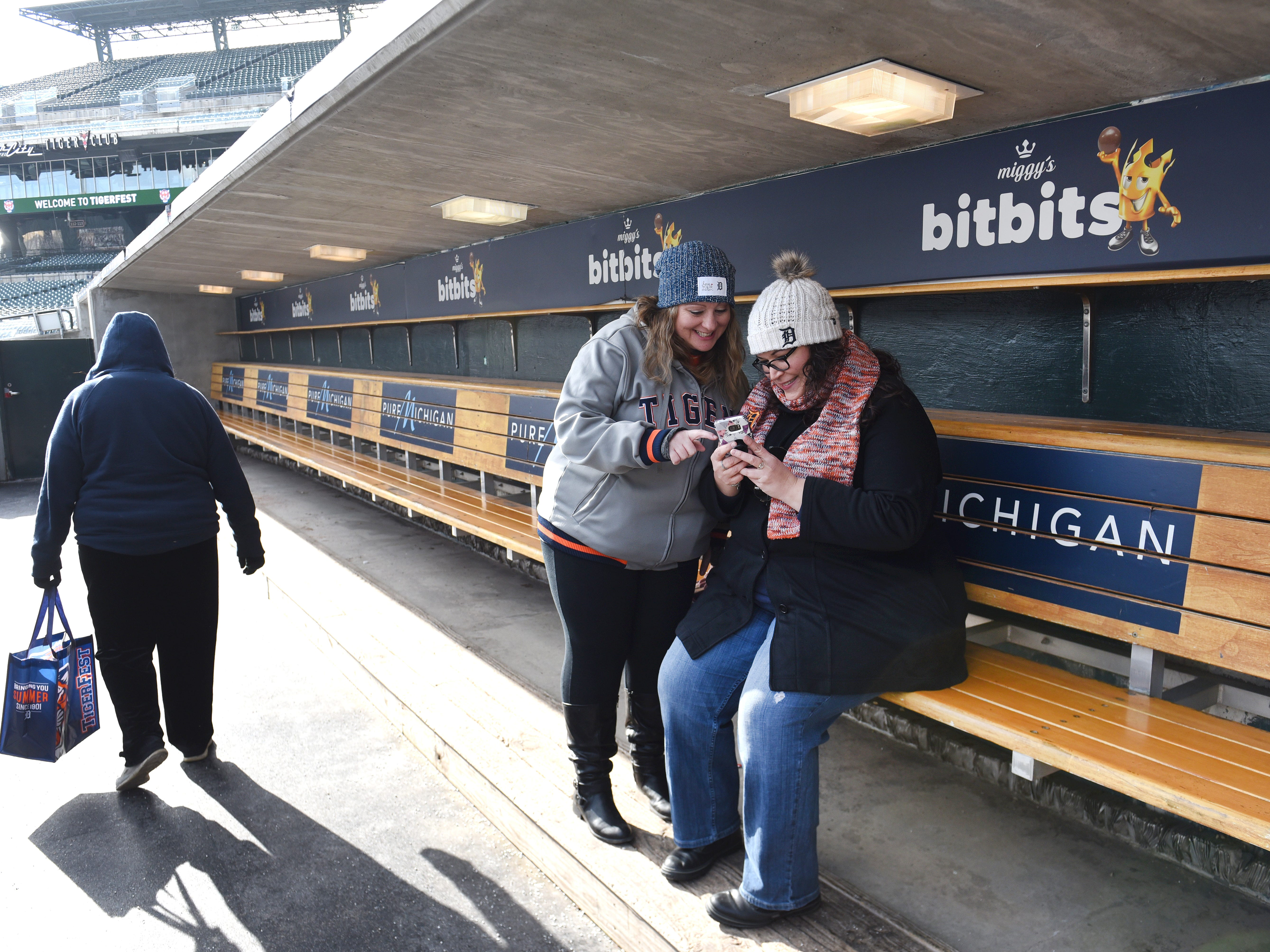 Kathy Baily (left) and Avanti Herczeg tour the visitors dugout during TigerFest 2019 at Comerica Park.