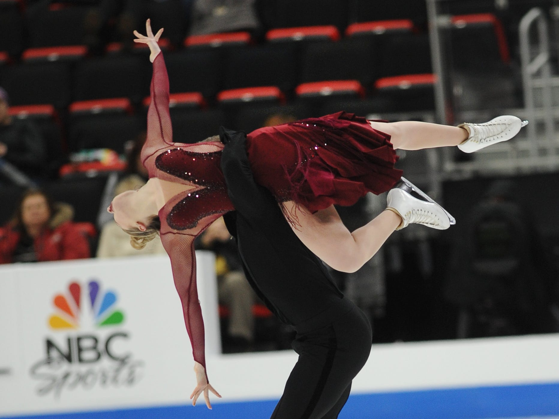 Christina Carreira and Anthony Ponomarenko perform during the rhythm dance competition.