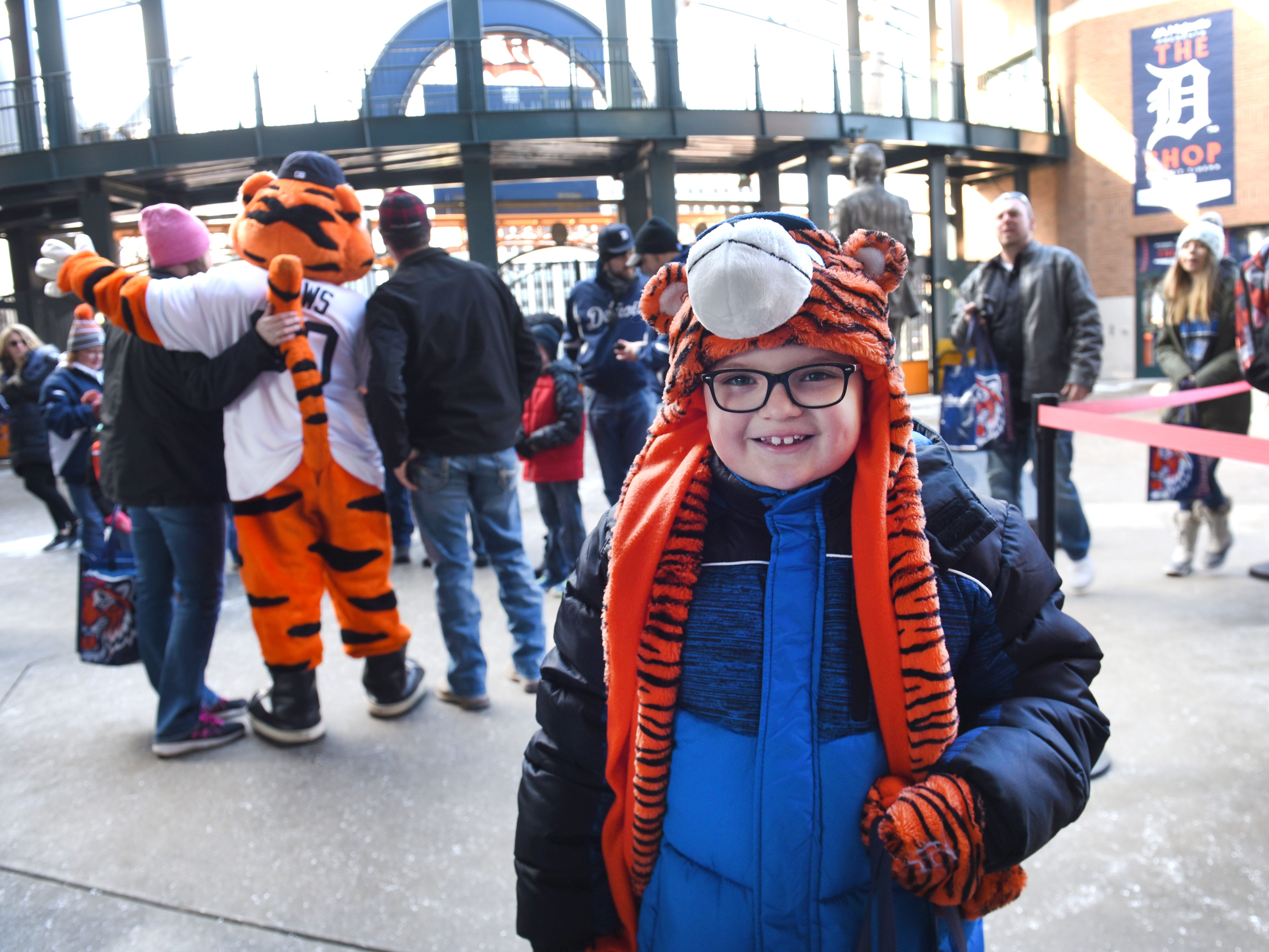 Brycen Oliver of Toledo prepares to meet Detroit Tigers mascot Paws at TigerFest .