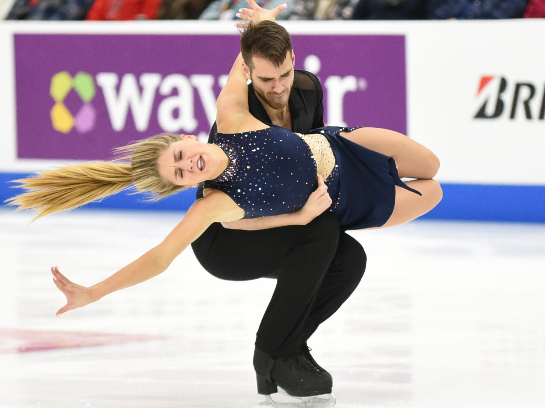 Lydia Erdman and Yuri Vlasenko perform during the rhythm dance competition.