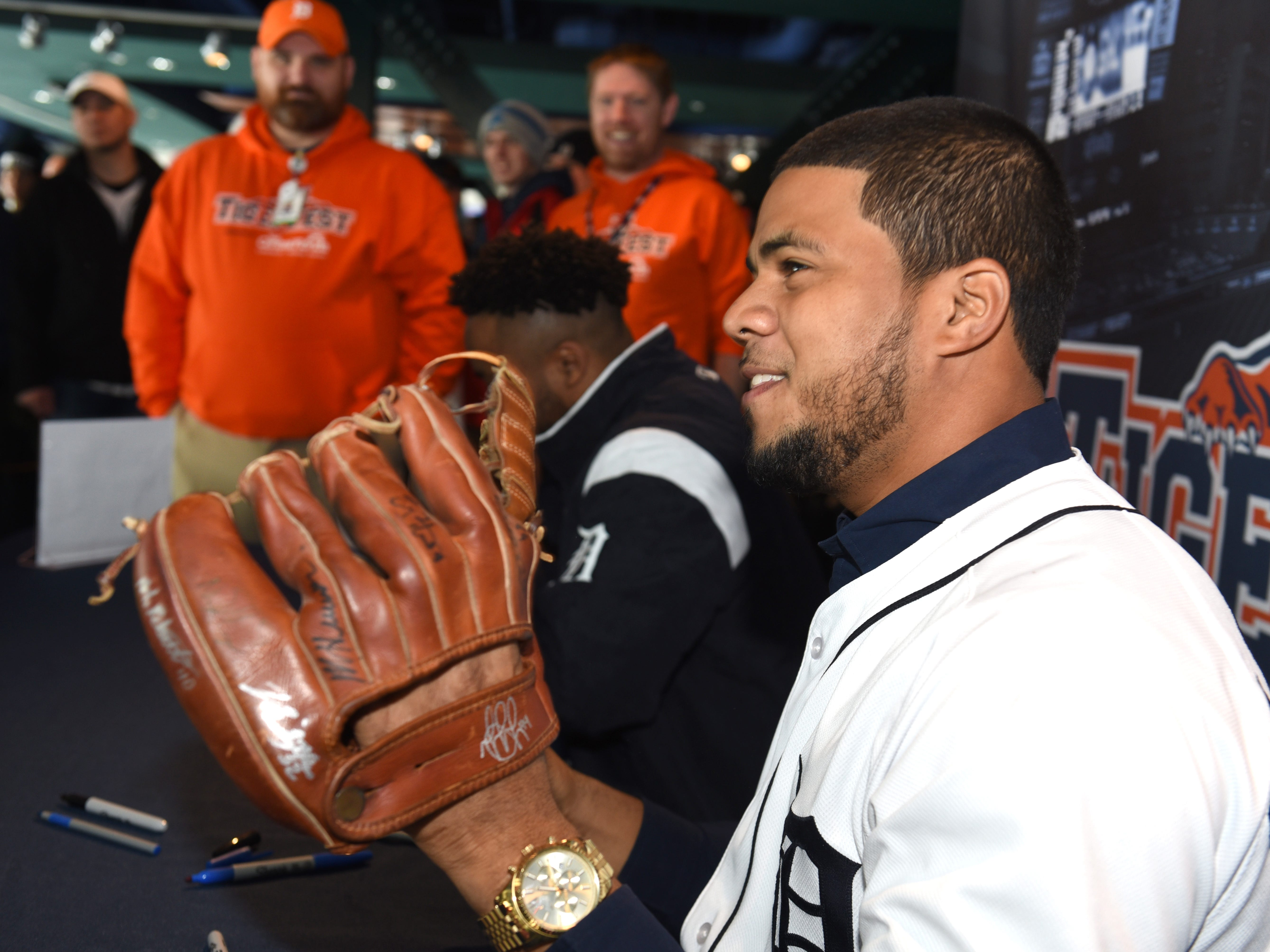 Detroit Tigers player Jeimer Candelario shows off a fans glove moments after he autographed it.