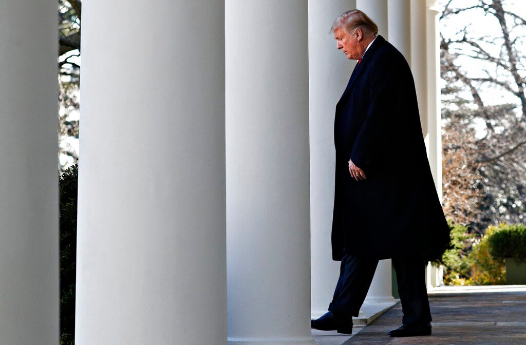 President Donald Trump walks through the colonnade of the White House on arrival to announce a deal to temporarily reopen the government, Friday, Jan. 25, 2019, from the Rose Garden of the White House in Washington.