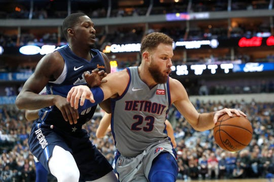 Pistons forward Blake Griffin is defended by Mavericks forward Dorian Finney-Smith during their recent game.