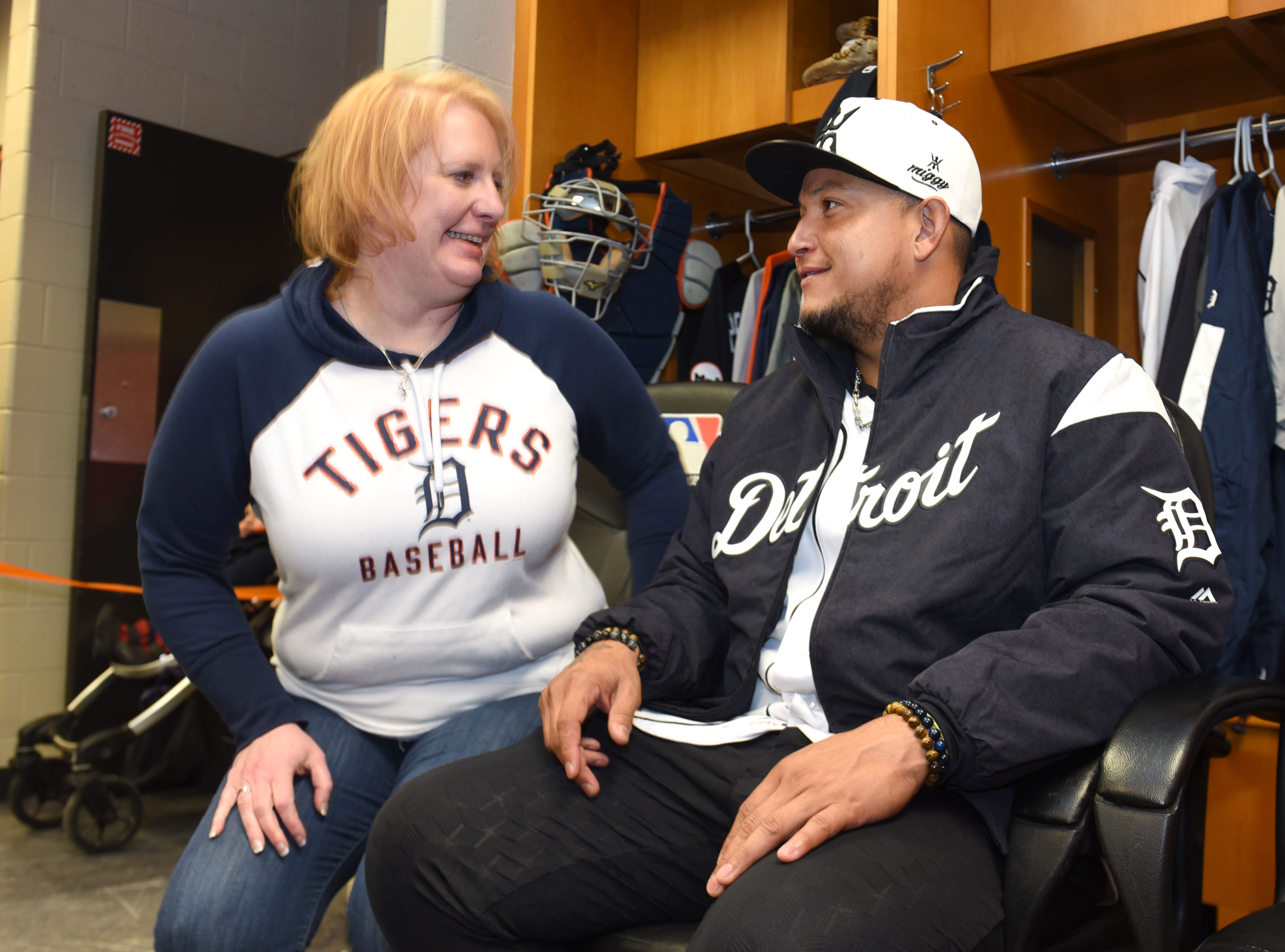 Kristen Moore of Lansing shares a moment with Detroit Tigers Miguel Cabrera in the players locker room at TigerFest on Saturday, January 26, 2019.