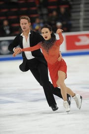 Madison Chock and Evan Bates perform during the rhythm dance competition.