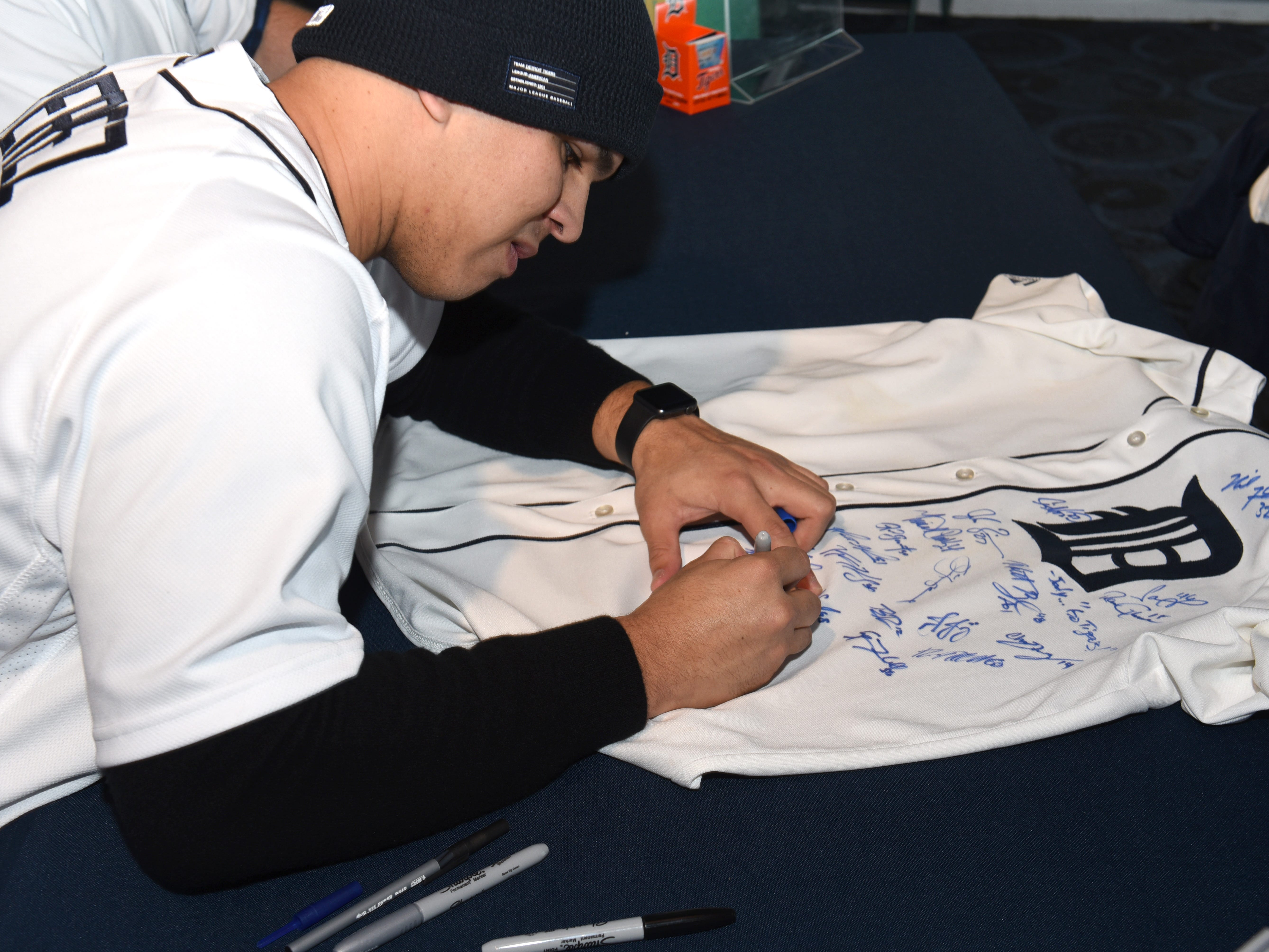 Detroit Tigers pitcher Franklin Perez signs a fan's jersey during TigerFest 2019 at Comerica Park.