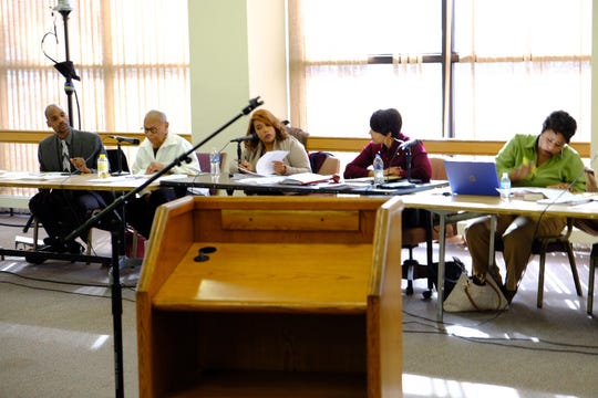 Members of the Detroit City Charter Revision Commission at a meeting on Saturday.