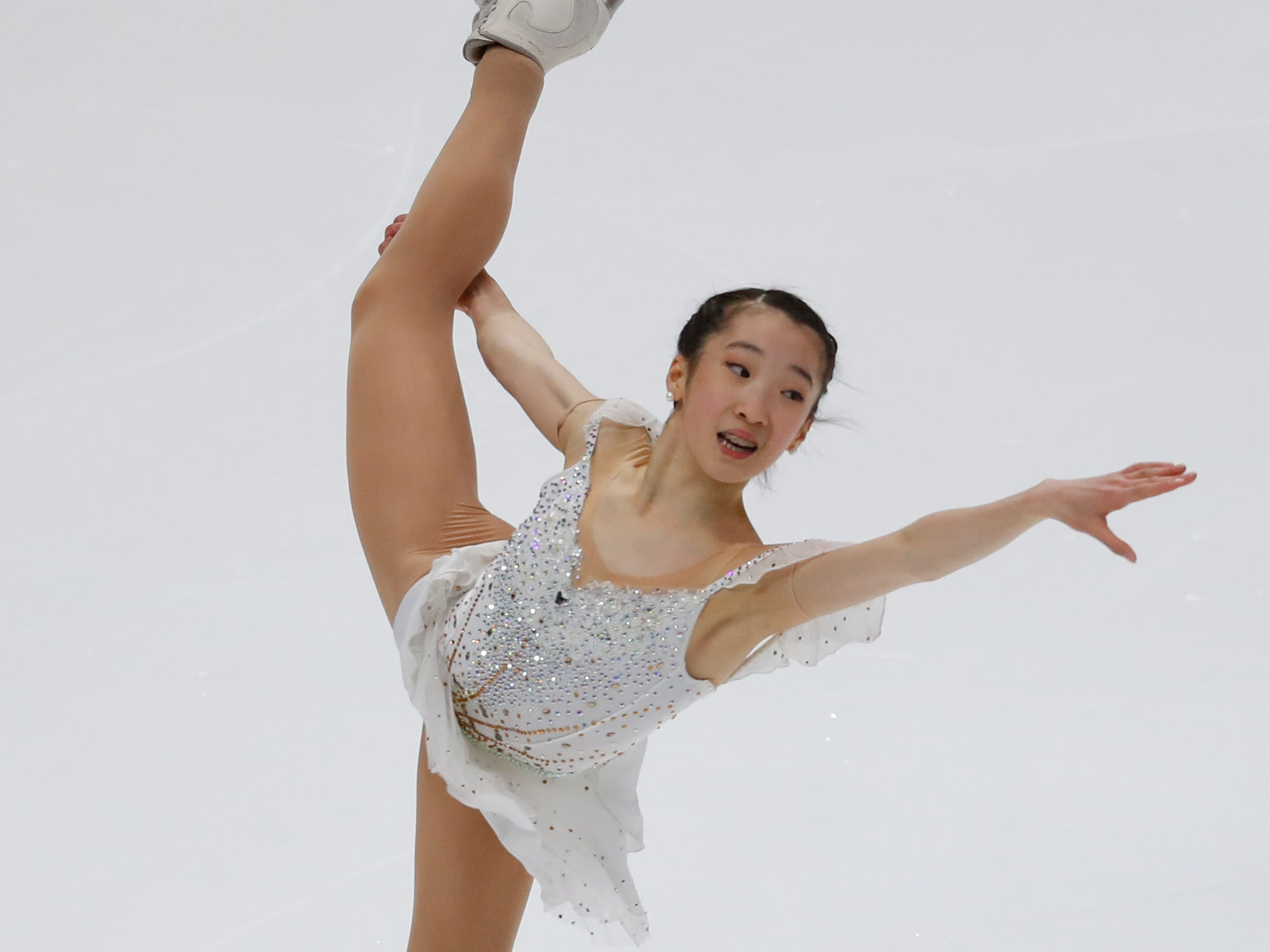 Ting Cui performs during her women's free skate program at the U.S. Figure Skating Championships, Friday, Jan. 25, 2019, in Detroit. (AP Photo/Paul Sancya)
