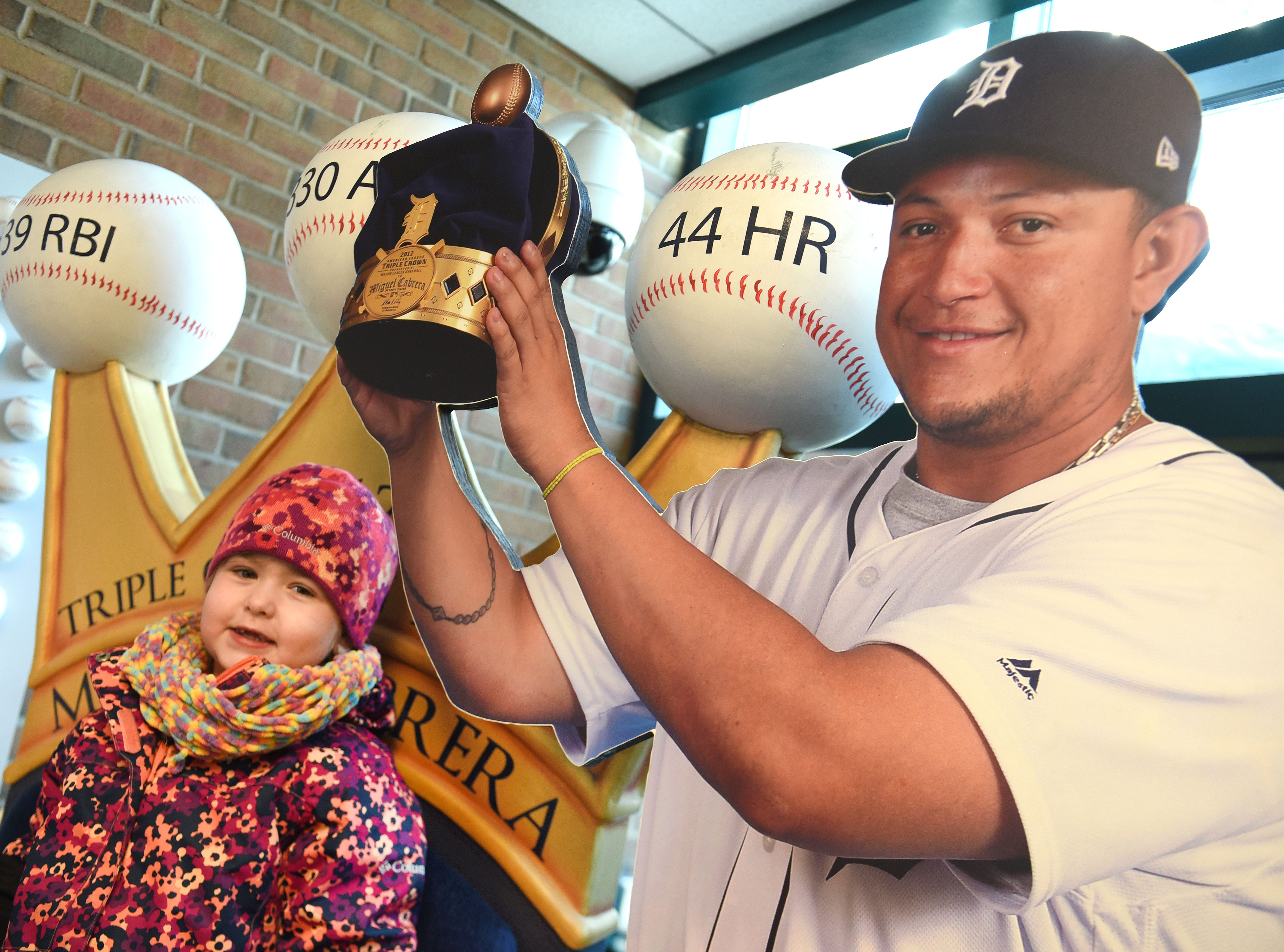 Emersyn Condon of Middleville enjoys posing with a cut out of her hero Miguel Cabrera during TigerFest 2019 at Comerica Park.