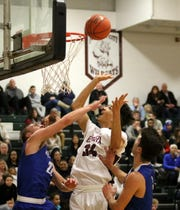 Elmira's Bryce Smith puts up a shot in between Hayden Robinson, left, and Mike Limoncelli of Horseheads on Jan. 25, 2019 at Elmira High School.