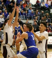 Lewis Clearwater of Horseheads loses the ball as Bryce Mattison, left, and Bryce Smith of Elmira defend Jan. 25, 2019 at Elmira High School.