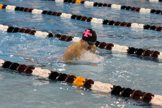 Flaminio Glaubitz of Ithaca swims to victory in the 200-yard individual medley at the John Beecher Boys Swimming and Diving Invitational at Elmira's Ernie Davis Academy on Jan. 26, 2019.
