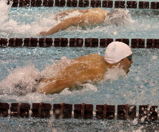Shoonhsin Li of Horseheads, bottom, swims to victory in the 100-yard butterfly at the John Beecher Boys Swimming and Diving Invitational at Elmira's Ernie Davis Academy on Jan. 26, 2019.