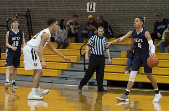 Reitz's Khristian Lander (4) calls a play during the Central vs Reitz basketball game at Central High School Friday, Jan. 25, 2019. Central won, 54-44.