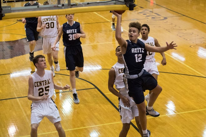 Reitz's Owen Dease (12) takes a shot during the Central vs Reitz basketball game at Central High School Friday, Jan. 25, 2019. Reitz defeated Central in the sectional semifinals.