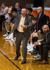Central Head Coach Rodney Walker call plays from the sideline during the Central vs Reitz basketball game at Central High School Friday, Jan. 25, 2019.