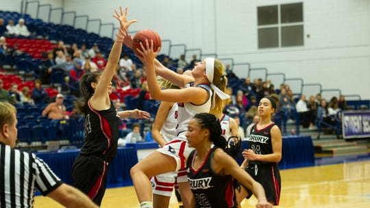 USI's Morgan Sherwood drives into the lane as No. 2-ranked Drury's Hailey Diestelkamp attempts to block the shot. The Eagles lost 77-50.