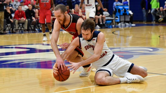 USI's Nate Hansen fights for a loose ball with Drury's Andrew Ballock in the second half of the Eagles' 76-72 loss to Drury Saturday.