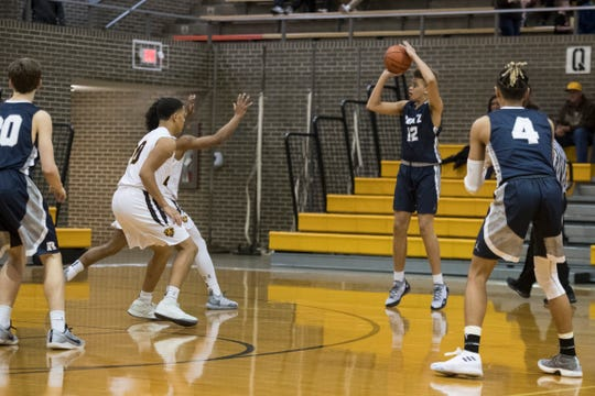 Reitz's Owen Dease (12) takes a three-point shot during the Central vs Reitz basketball game at Central High School Friday, Jan. 25, 2019. Central won, 54-44.