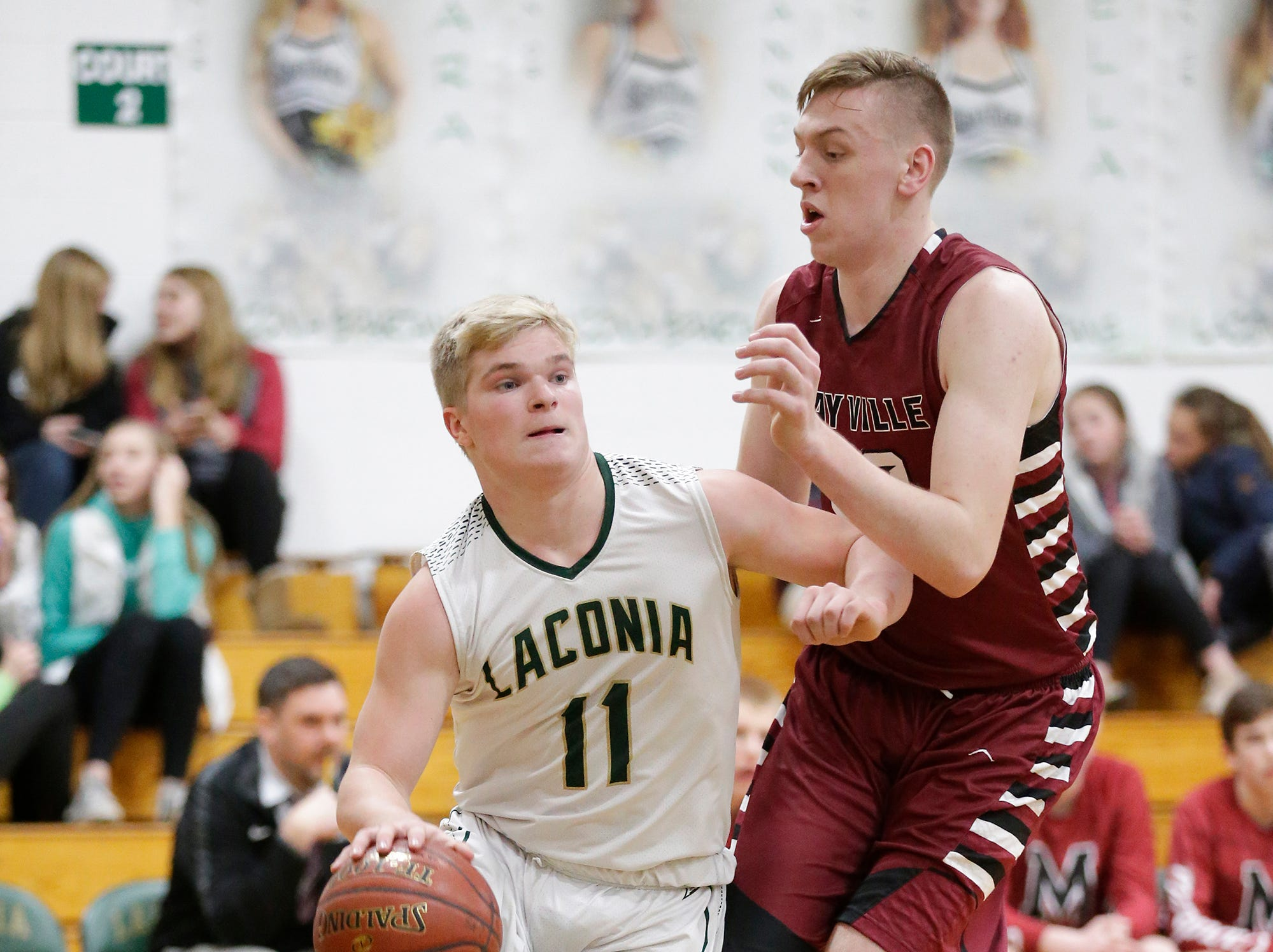 Laconia High School boys basketball's Eli Leonard works around Mayville High School's Logan Arroyo during their game Friday, January 25, 2019 in Rosendale. Laconia won the game 80-54. Doug Raflik/USA TODAY NETWORK-Wisconsin