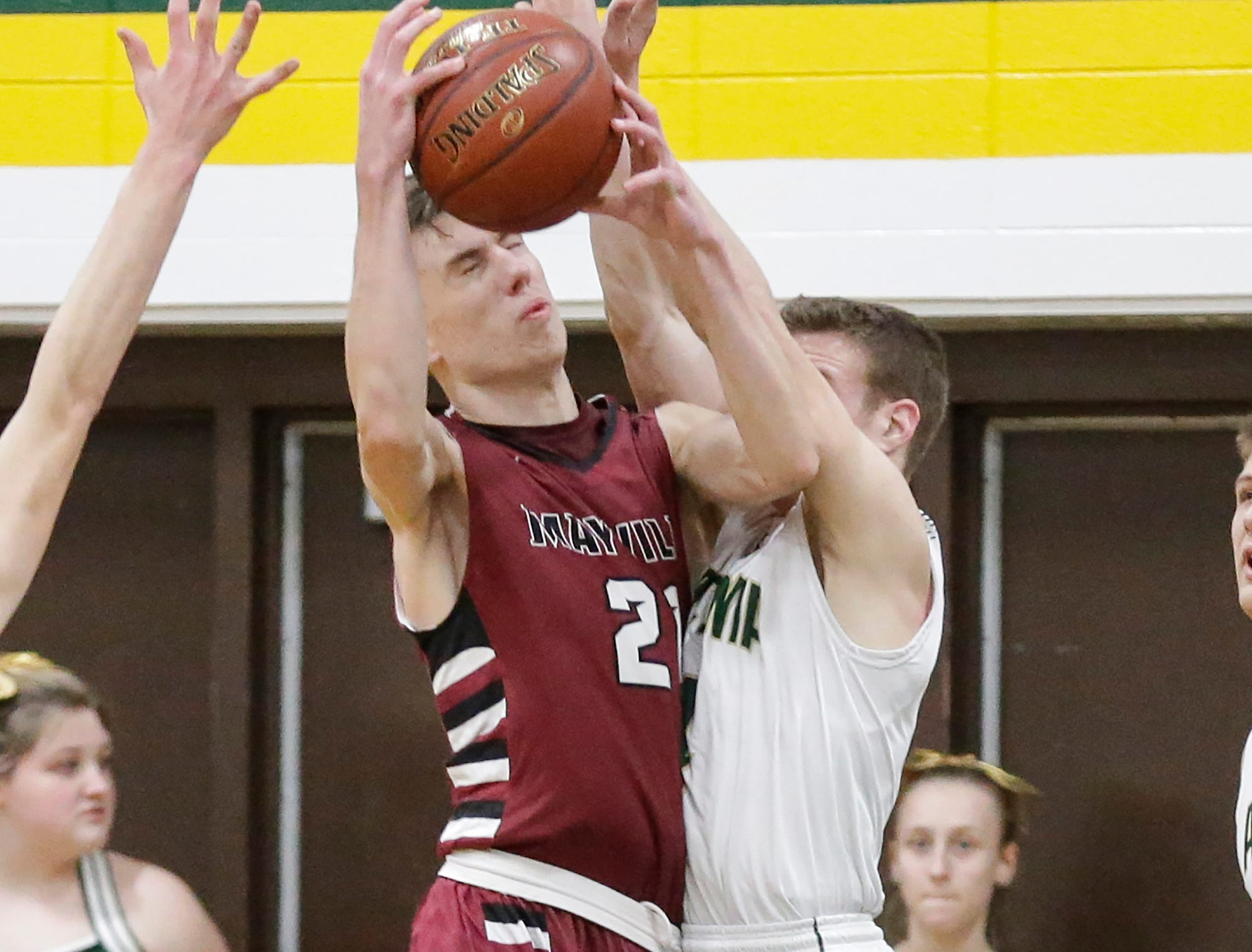 Mayville High School boys basketball's Jackson Mittelstadt and Laconia High School's Jake Davies collide during their game Friday, January 25, 2019 in Rosendale. Laconia won the game 80-54. Doug Raflik/USA TODAY NETWORK-Wisconsin