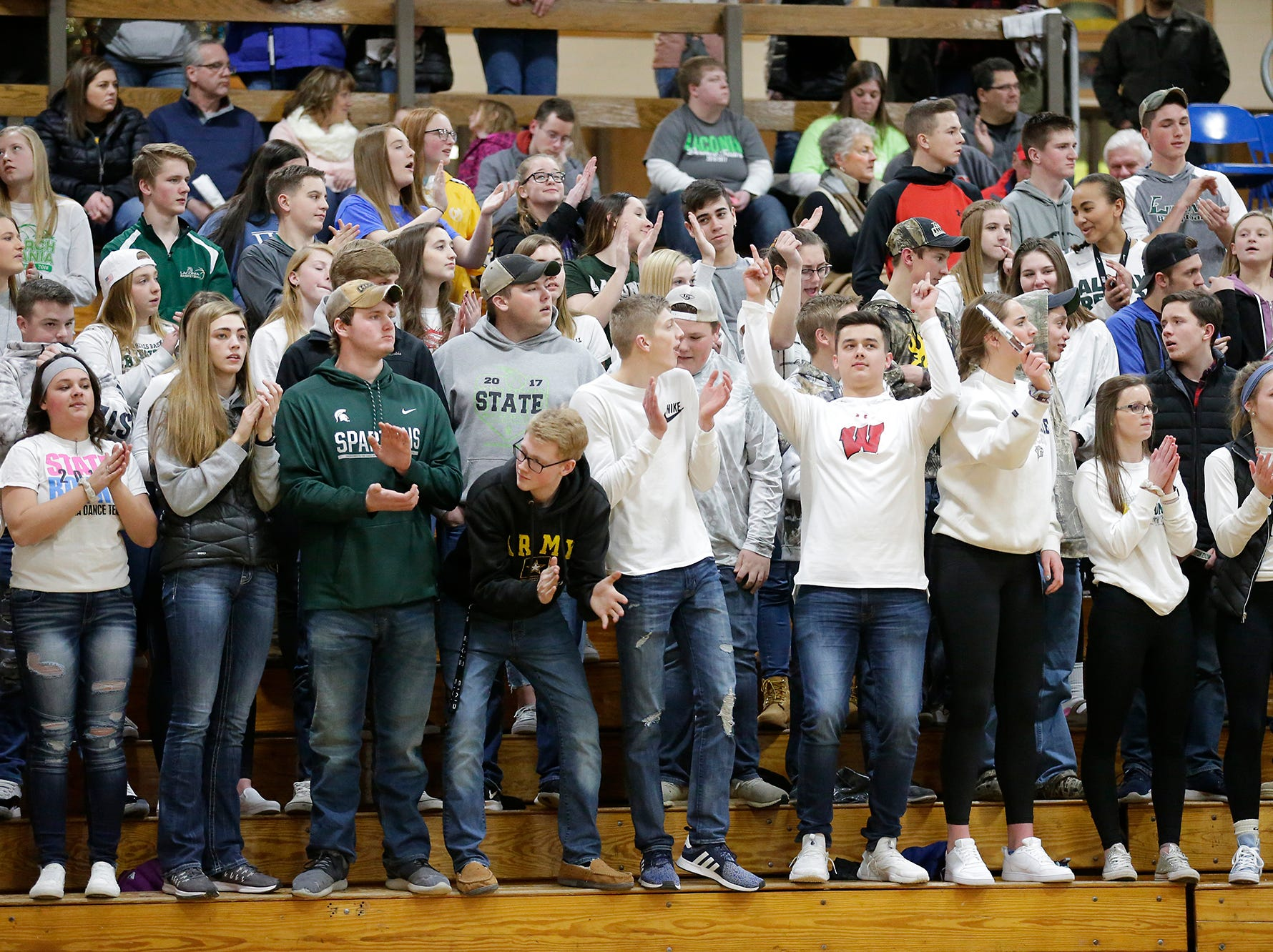 Laconia High School boys basketball fans celebrate a basket against Mayville High School during their game Friday, January 25, 2019 in Rosendale. Laconia won the game 80-54. Doug Raflik/USA TODAY NETWORK-Wisconsin