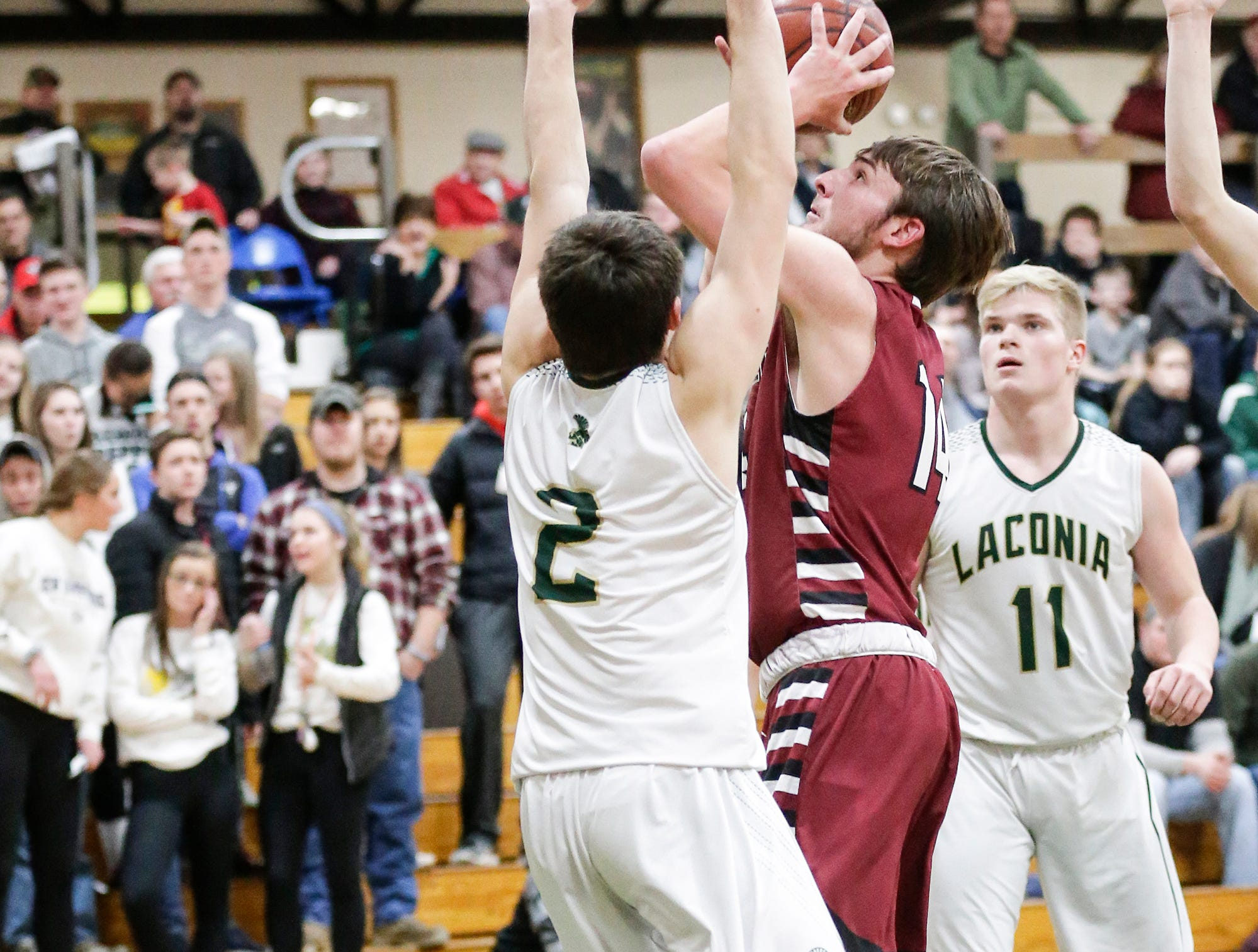 Mayville High School boys basketball's Tyler Gutjahr shoots over Laconia High School's Caden Wittchow during their game Friday, January 25, 2019 in Rosendale. Laconia won the game 80-54. Doug Raflik/USA TODAY NETWORK-Wisconsin