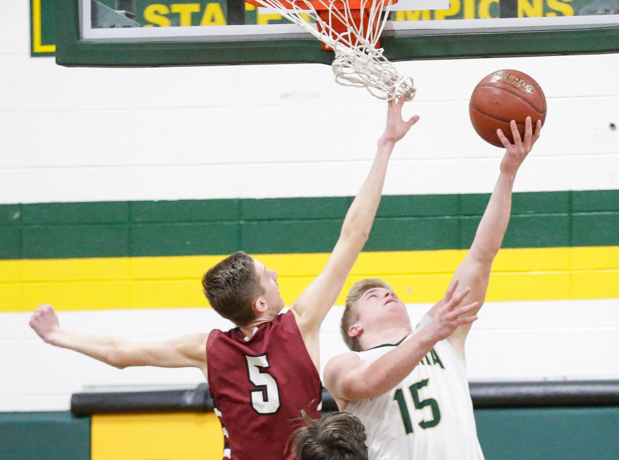 Laconia High School boys basketball's Isaac Leonard makes this basket while Mayville High School's Isaac Wolf defends him during their game Friday, January 25, 2019 in Rosendale. Laconia won the game 80-54. Doug Raflik/USA TODAY NETWORK-Wisconsin
