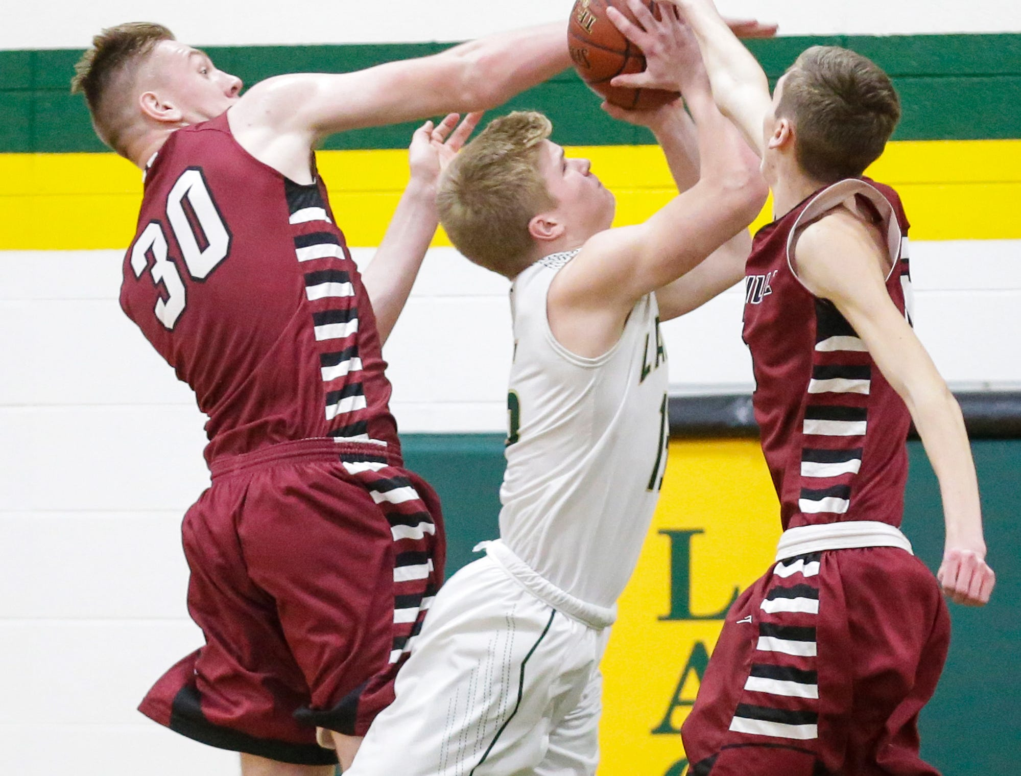 Laconia High School boys basketball's Isaac Leonard shoots between Mayville High School's Logan Arroyo (30) and Isaac Wolf (5) during their game Friday, January 25, 2019 in Rosendale. Laconia won the game 80-54. Doug Raflik/USA TODAY NETWORK-Wisconsin