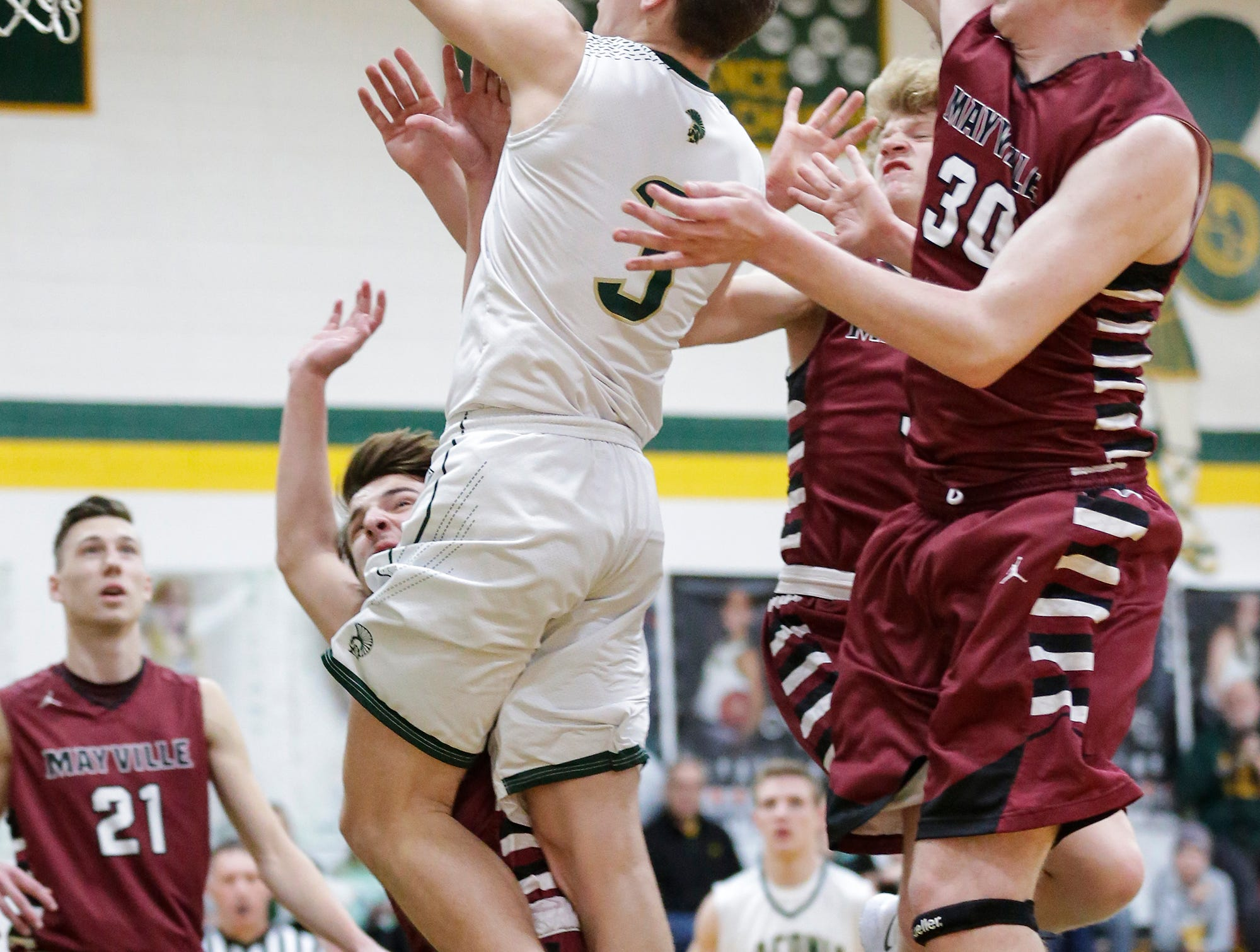 Laconia High School boys basketball's Reed Gunnink gets fouled by Mayville High School's Tyler Gutjahr (14) while Logan Arroyo reaches from behind during their game Friday, January 25, 2019 in Rosendale. Laconia won the game 80-54. Doug Raflik/USA TODAY NETWORK-Wisconsin