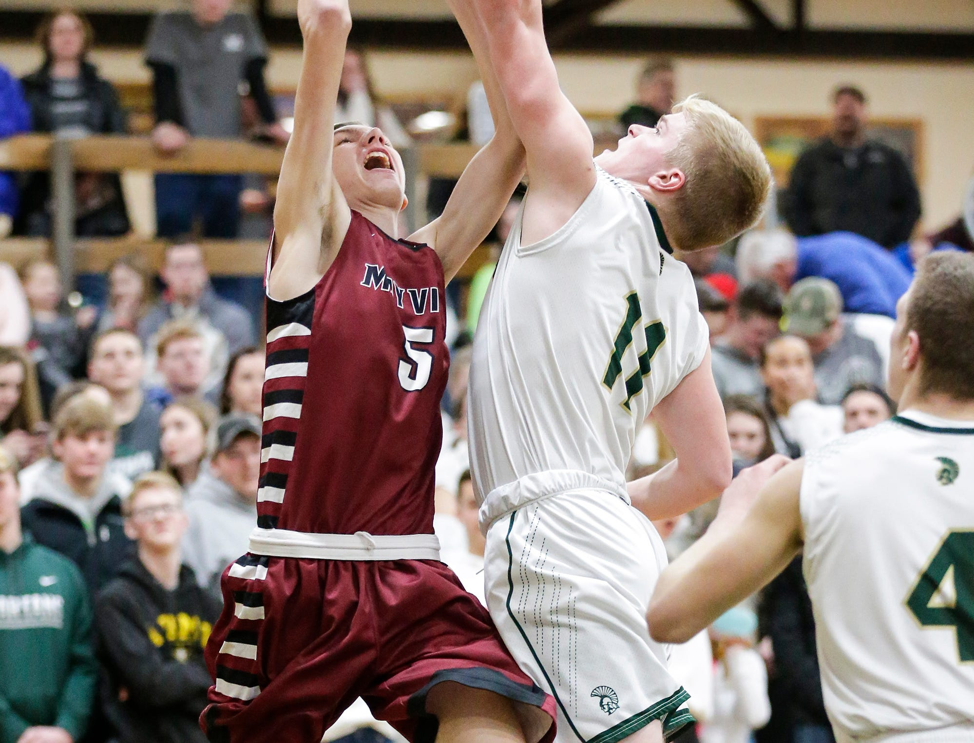 Mayville High School boys basketball's Isaac Wolf goes up for a shot against Laconia High School's Eli Leonard during their game Friday, January 25, 2019 in Rosendale. Laconia won the game 80-54. Doug Raflik/USA TODAY NETWORK-Wisconsin
