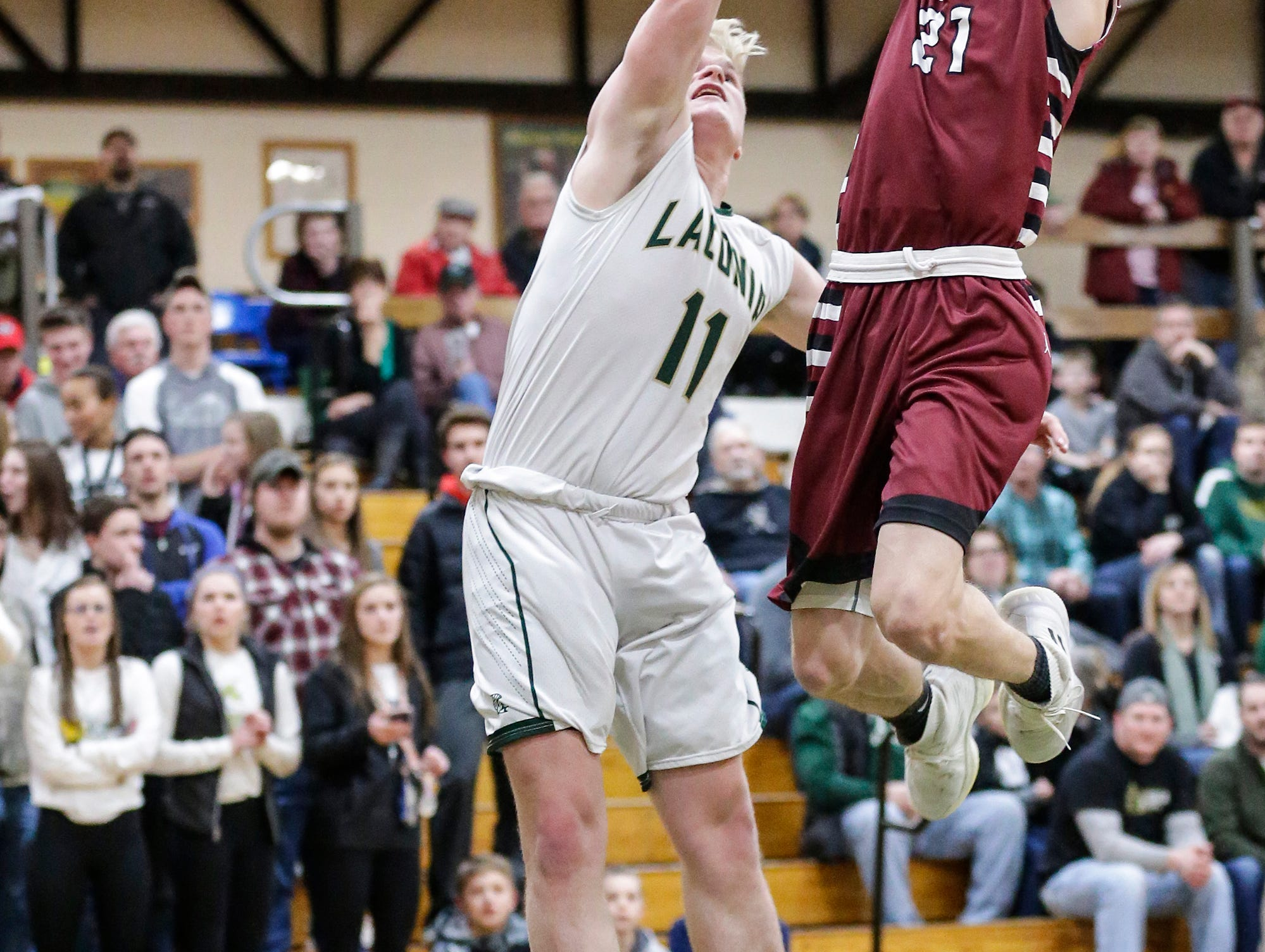 Laconia High School boys basketball's Eli Leonard fouls Mayville High School's Jackson Mittelstadt during their game Friday, January 25, 2019 in Rosendale. Laconia won the game 80-54. Doug Raflik/USA TODAY NETWORK-Wisconsin