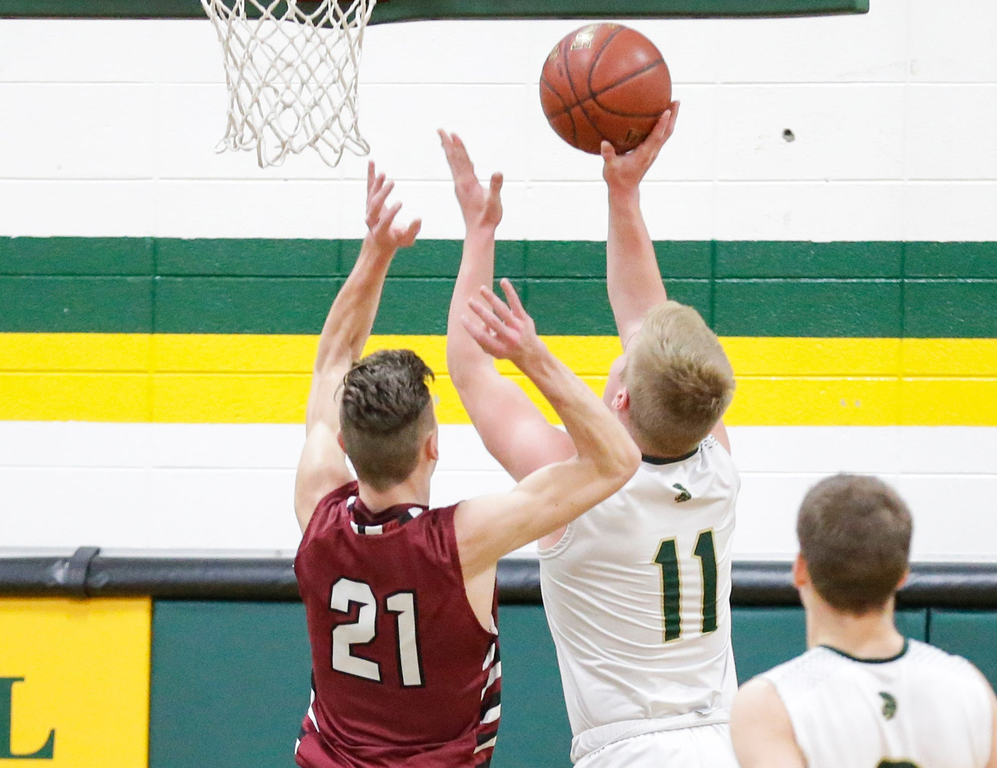 Laconia High School boys basketball's Eli Leonard goes up for a basket against Mayville High School's Jackson Mittelstadt during their game Friday, January 25, 2019 in Rosendale. Laconia won the game 80-54. Doug Raflik/USA TODAY NETWORK-Wisconsin