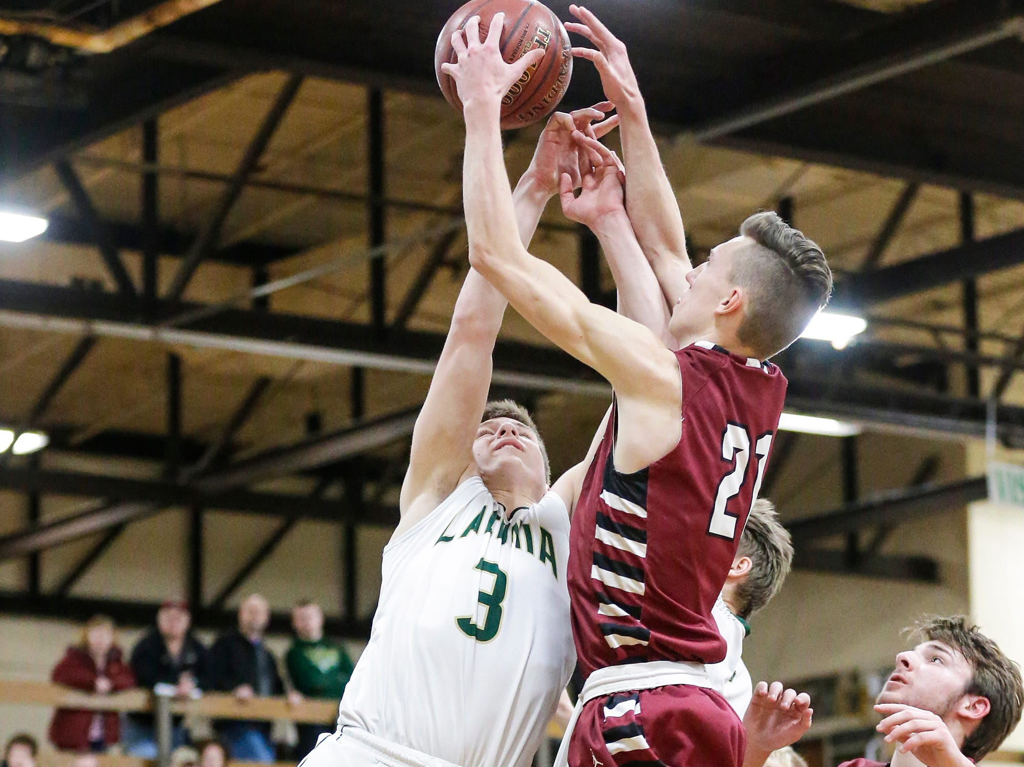Laconia High School boys basketball's Reed Gunnink and Mayville High School's Jackson Mittelstadt battle for a rebound during their game Friday, January 25, 2019 in Rosendale. Laconia won the game 80-54. Doug Raflik/USA TODAY NETWORK-Wisconsin