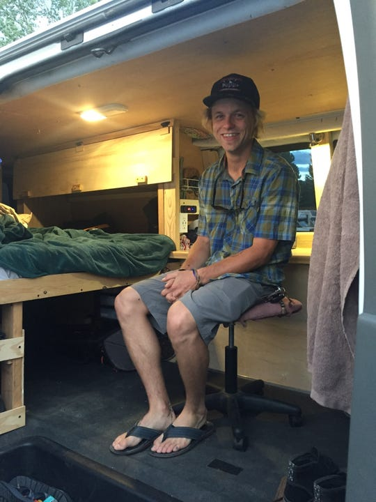Ben Hunter in his Chevy Express van, where he lives part of the year.