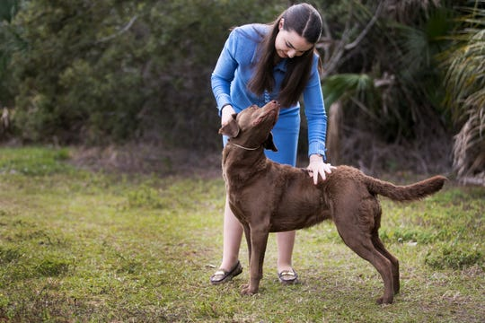 Jessica Braatz, 14, shares a special bond with her dog Styx. They compete in and win dog shows together, and Styx is also one of the family pets.