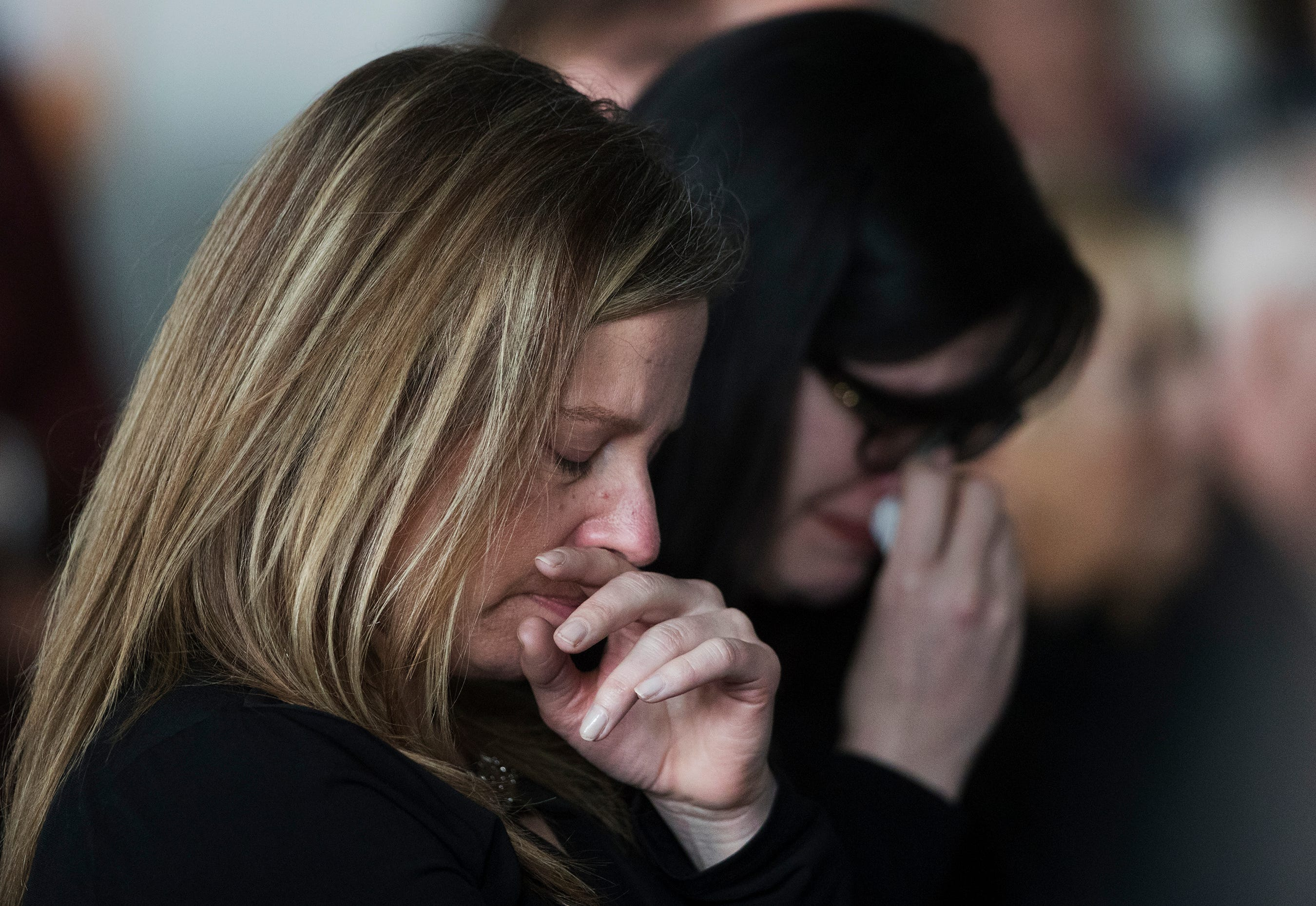 Kristy Hommerding weeps during a memorial service for her uncle, Leroy Hommerding, on Saturday at the Fort Myers Beach Public Library. Hommerding, 69, the library's director, was fatally stabbed on Jan. 20, as he opened the library for a book sale.