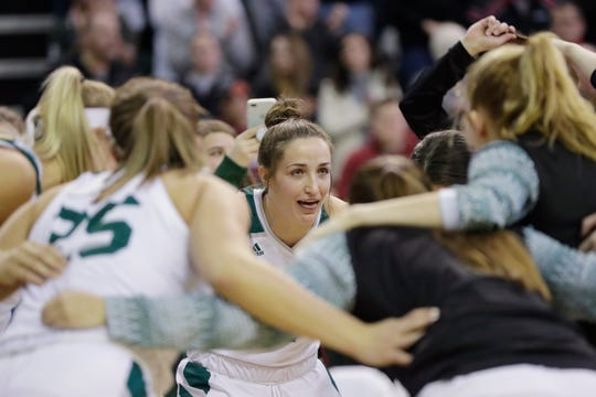 UWGB guard Jen Wellnitz (1) huddles with the team before a game this season. The senior standout was named the Horizon League's defensive player of the year on Tuesday for the second straight season.