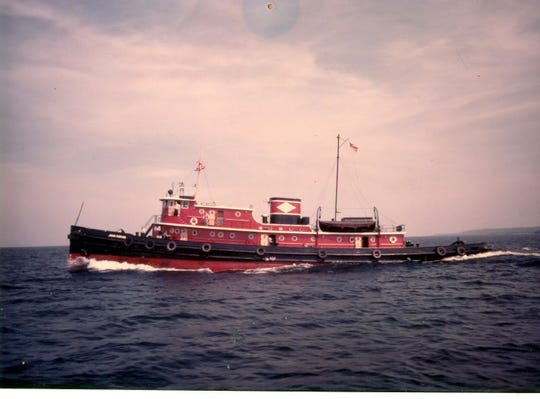"A photo of the tug John Purves, which is now docked outside the Door County Maritime Museum in Sturgeon Bay. the photo is part of ""The Water Defines Us: DCMM@50,"" the Door County Maritime Museum exhibit celebrating the museum's 50th anniversary."