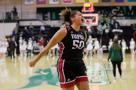 IUPUI Jaguars forward/center Macee Williams (50) celebrates as she leaves the court after the Jaguars defeated the Green Bay Phoenix.