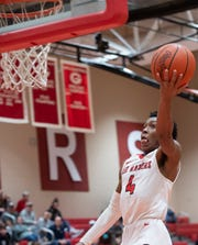 Greenville High School's Dorian Williams (4) makes a basket during the home game against Blue Ridge High School Friday, Jan. 25, 2019.