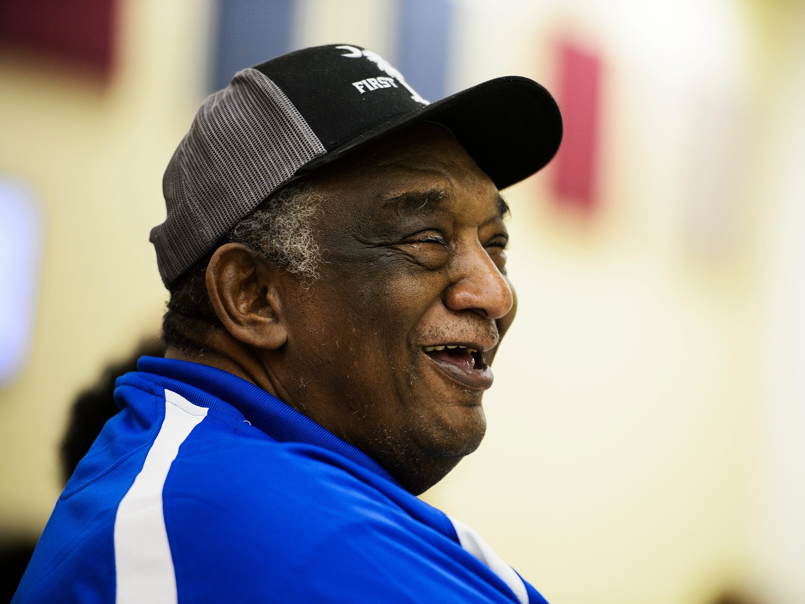 Louie Golden laughs as he is honored by several of his former players and colleagues on Friday, Jan. 25 2019 at Riverside High School.