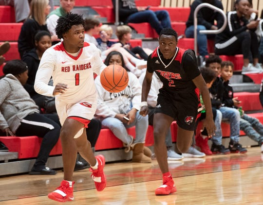 Greenville High School's Malik Norris (1) controls the ball during the home game against Blue Ridge High School Friday, Jan. 25, 2019.